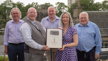 Chairperson Margaret O'Connor being presented with TPAS award