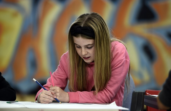 Photo of girl drawing.