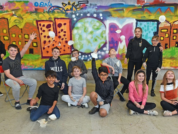 Photo of young tenants learning street art.