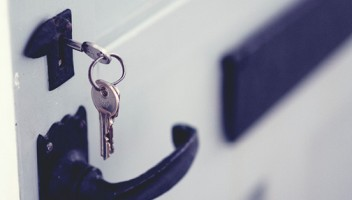 Photo of a key in a lock.