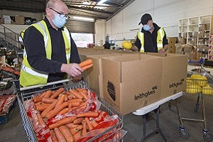 Photo of food hampers being packed.